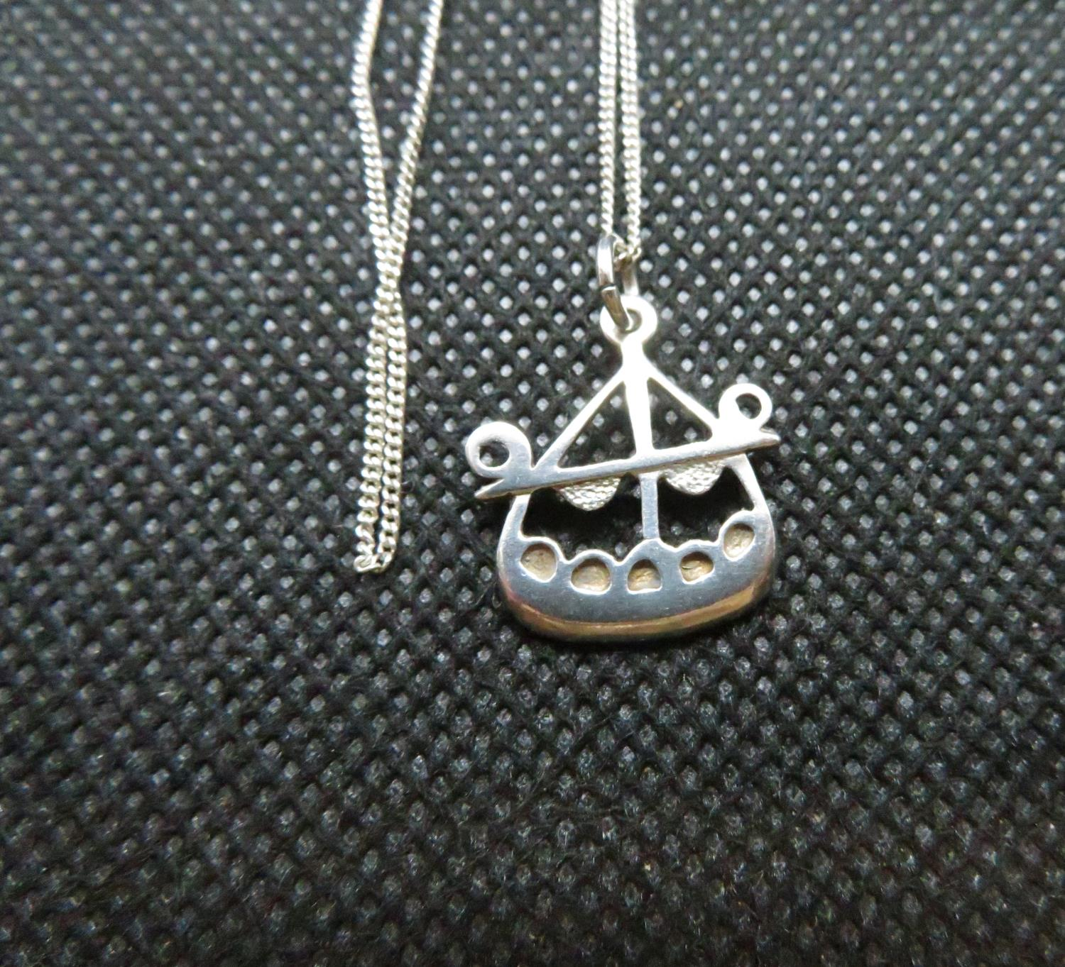 "Lot 30 - Celtic style Viking ship pendant by OLA M GORIE on 18"" silver curb link chain"
