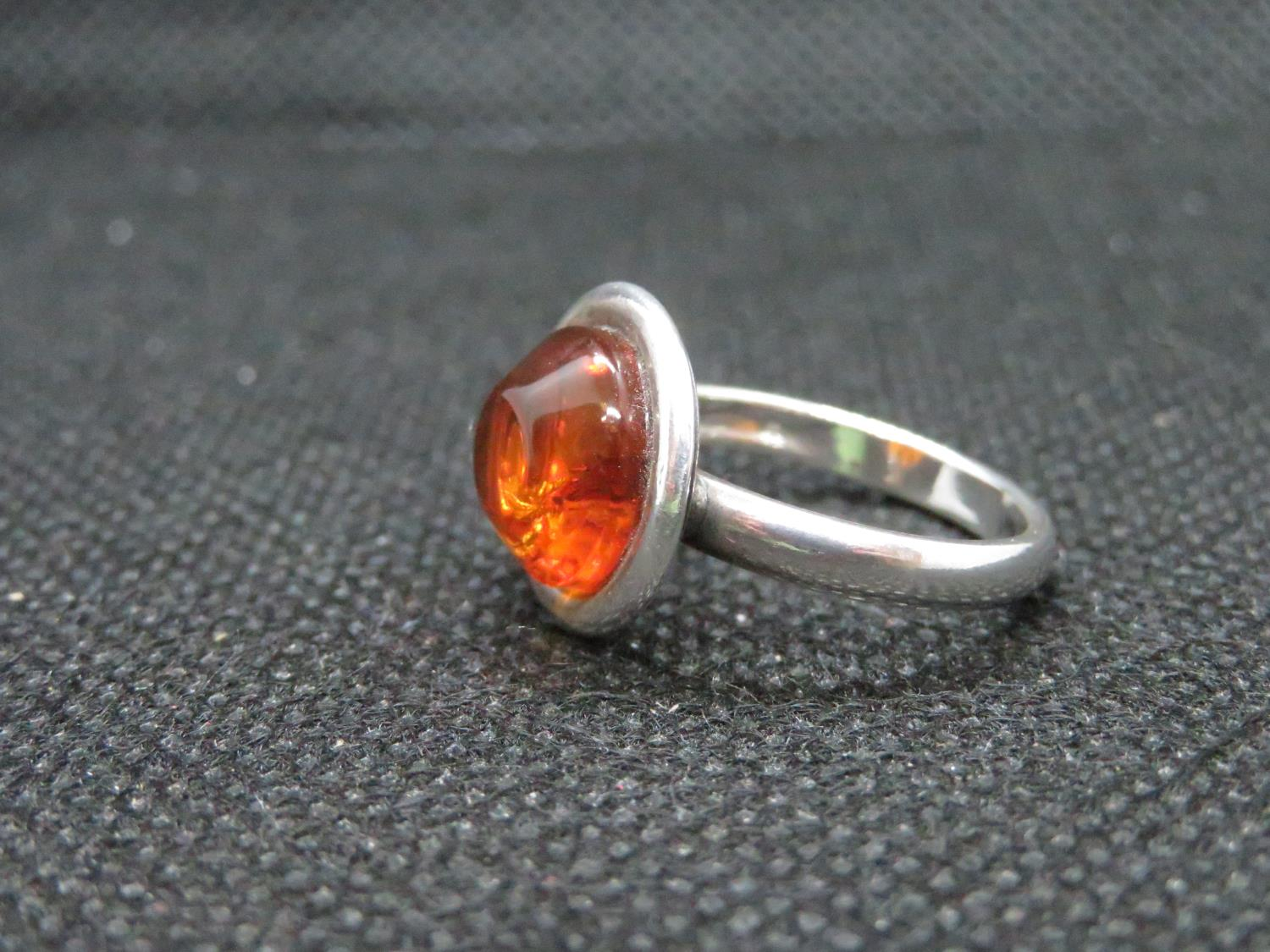 Lot 6 - Silver round amber cabochon ring