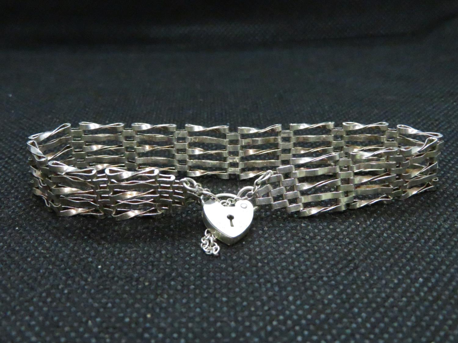 Lot 21 - Silver 5 bar gate bracelet with lock and safety chain HM London 1990 6.5grams