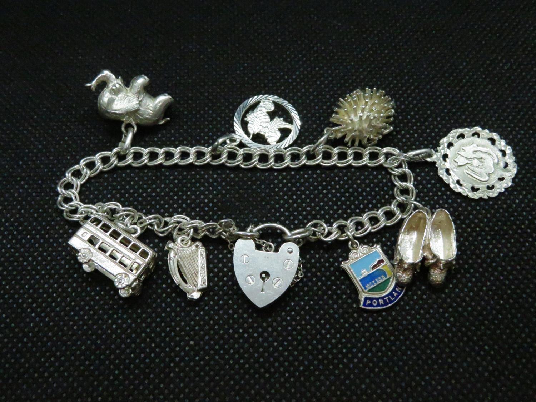 Lot 56 - Vintage silver double link charm bracelet with 7x charms London 1979HM