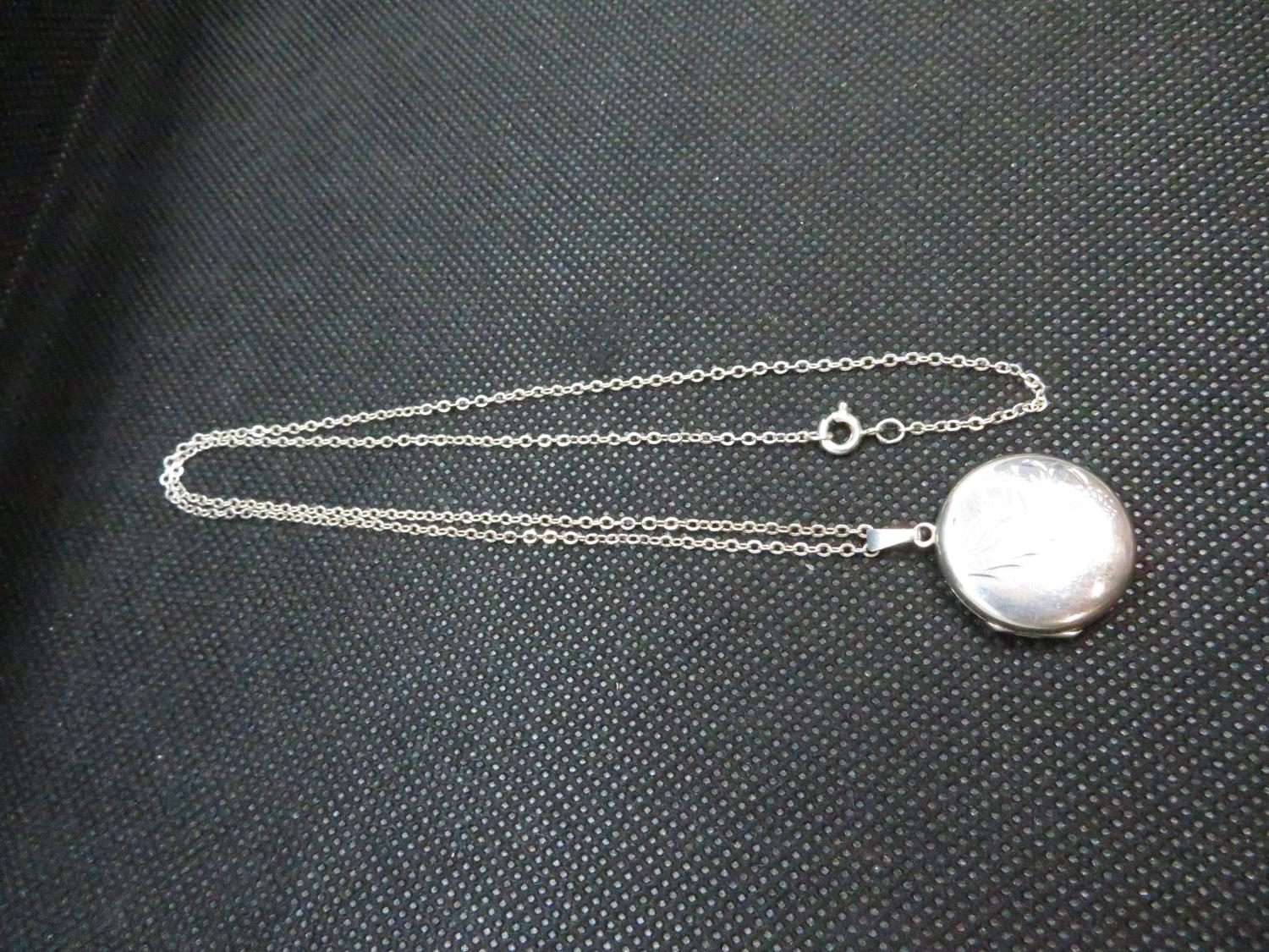 """Lot 14 - Vantage silver locket stamped silver on 18"""" silver trace link chain 5.7grams"""