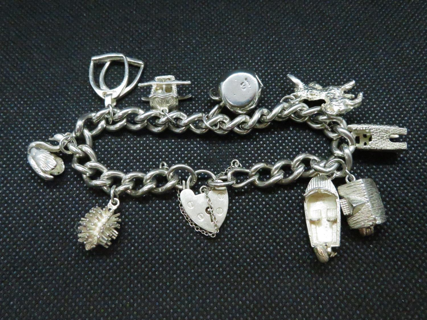 Lot 34 - Vintage silver charm bracelet with 9x nice charms HM London 1978 65 grams