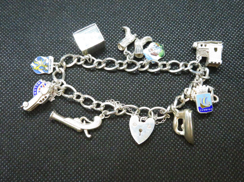 Lot 44 - Vintage silver bracelet with 2 charms HM Birmingham 1972 32.5grams