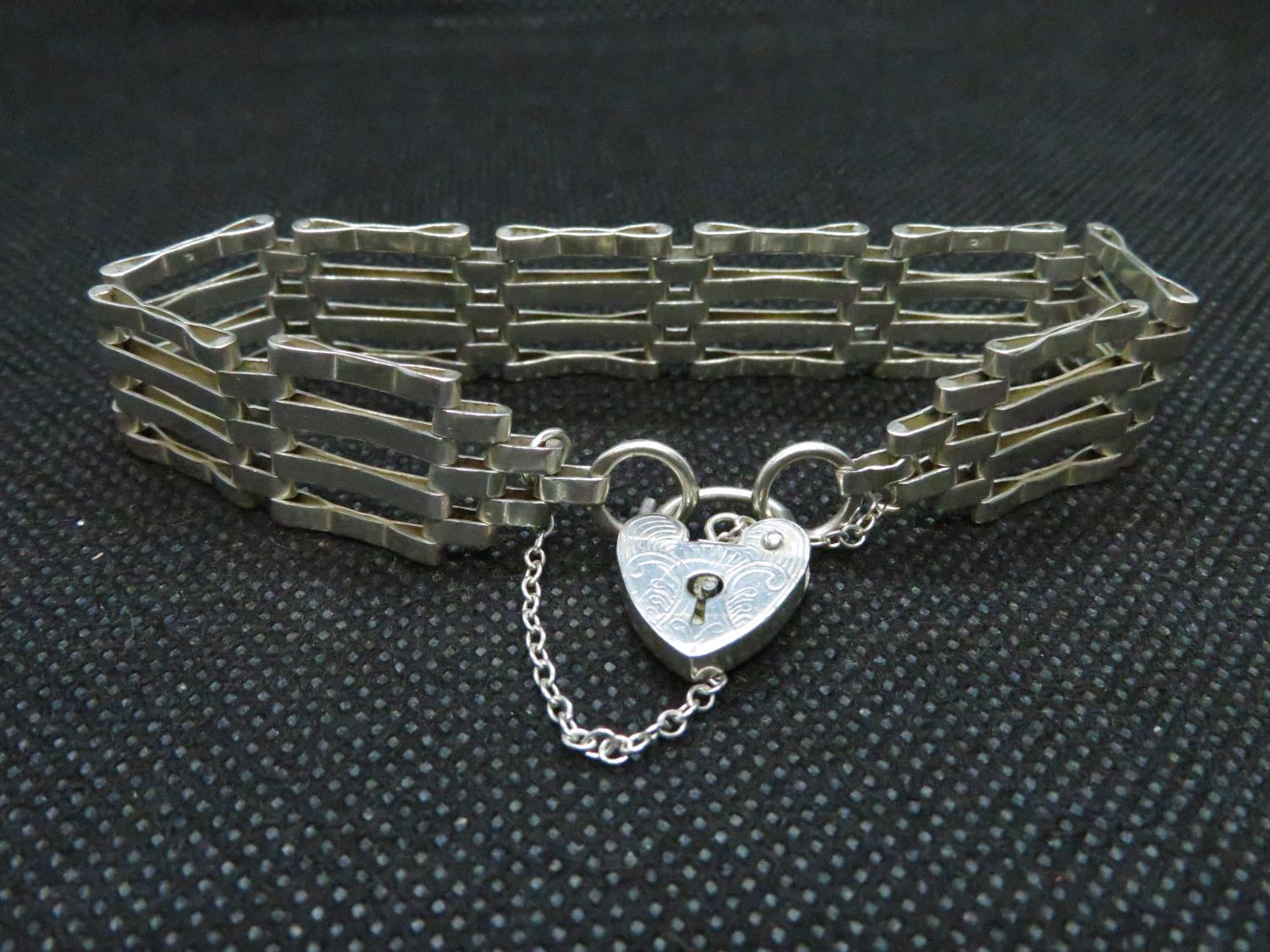 Lot 43 - Vintage silver 4 bar gate bracelet with lock and chain HM London 1979 16grams