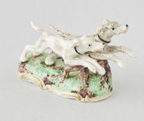 Porzellanfigur, NymphenburgZwei Hunde, bemalt u. teilweise Gold verziert, Pressmarke Nymphenburg,