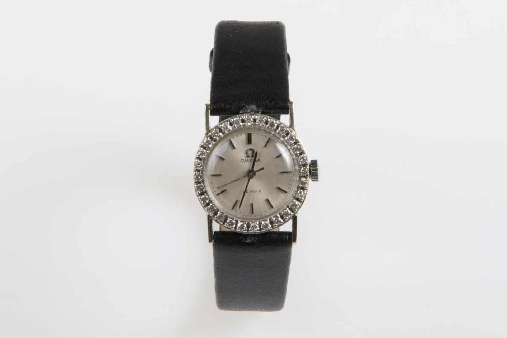 Damenarmbanduhr Omega de VilleHandaufzug, mit Brillanten zus.ca.0,60 ct.,schwarzes Lederband, 14,1g,