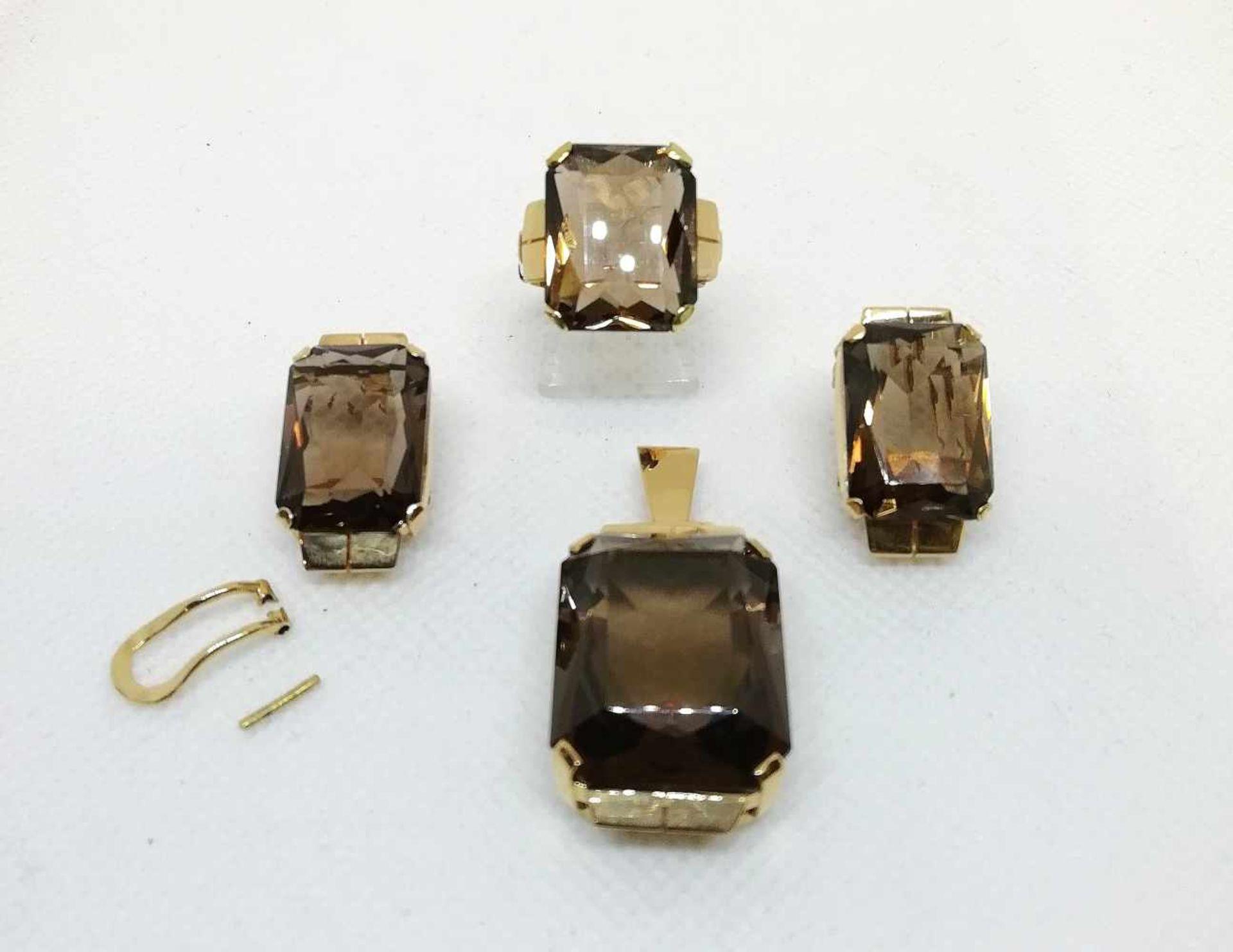 Garnitur:Gold 585, mit je 1 Rauchquarz, bestehnd aus: 1 Ring, RW 54, 1 Anhänger, Paar Ohrclipse,