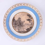 Decorative plate with a landscape scene. IFZ. [Early XIX century].Russia. Porcelain, decal, gilding.