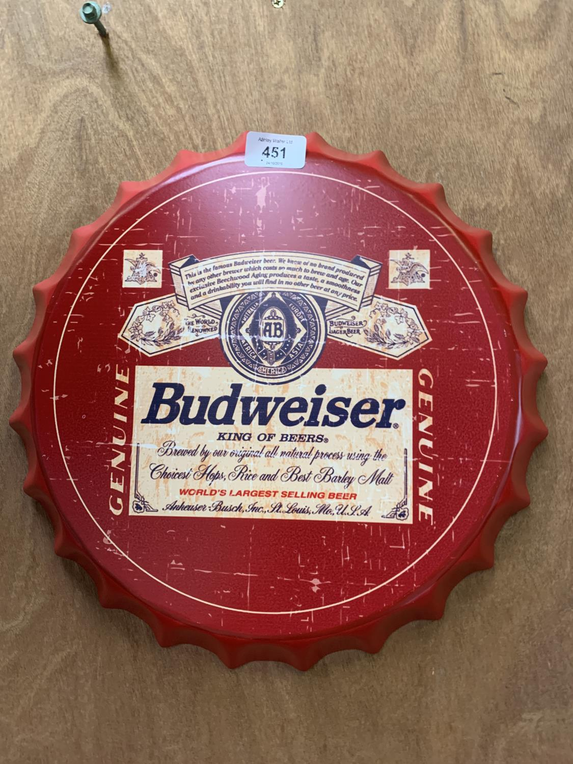 Lot 451 - A COLLECTABLE METAL BEER BOTTLE CAP 'BUDWEISER' SIGN