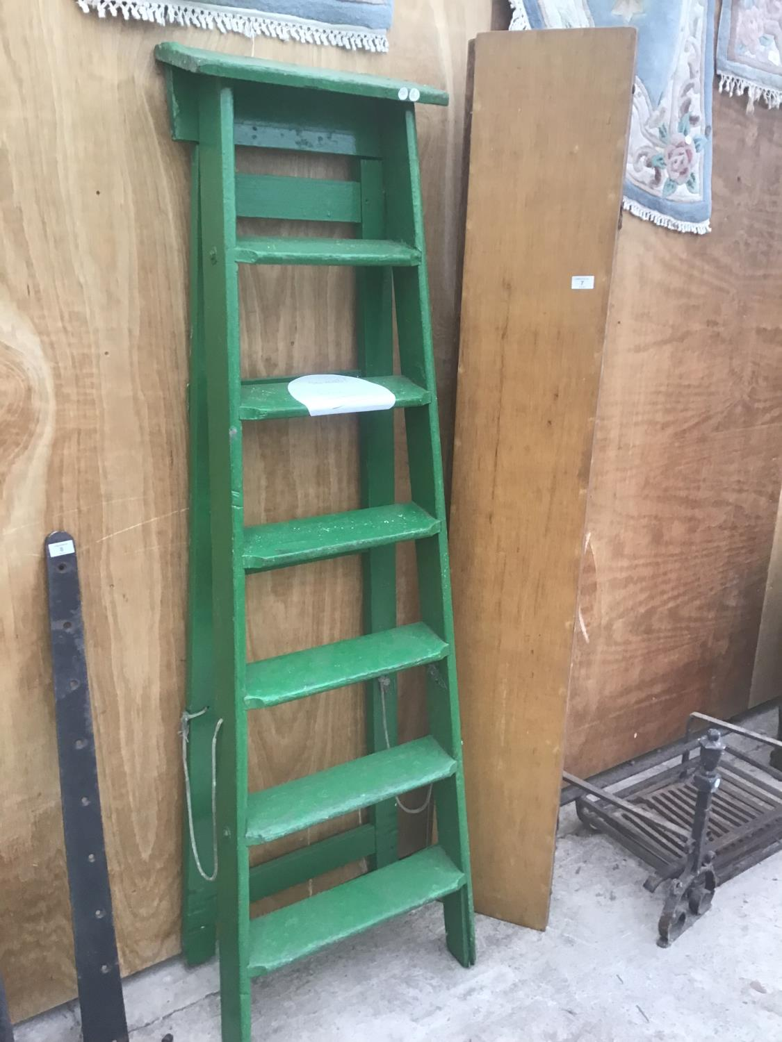 Lot 7 - A VINTAGE SIX STEP GREEN PAINTED WOODEN STEP LADDER AND A VINTAGE FOLDING WOODEN TABLE