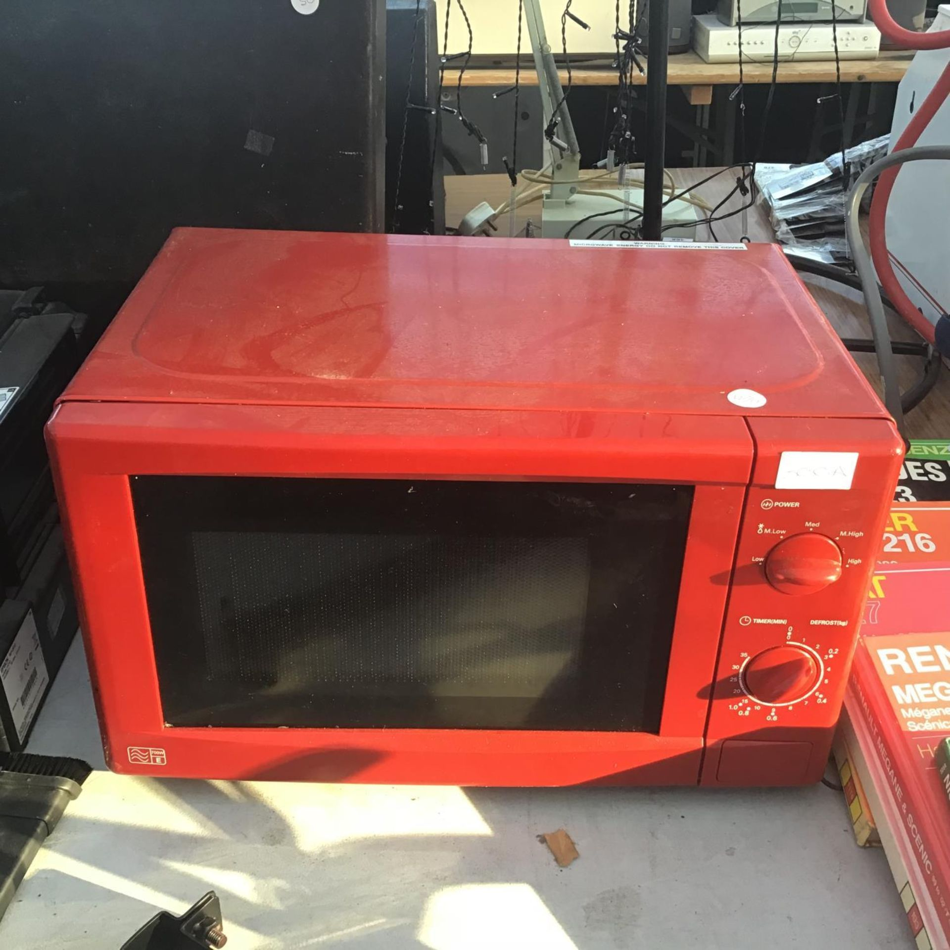 Lot 300A - A RED MICROWAVE IN WORKING ORDER