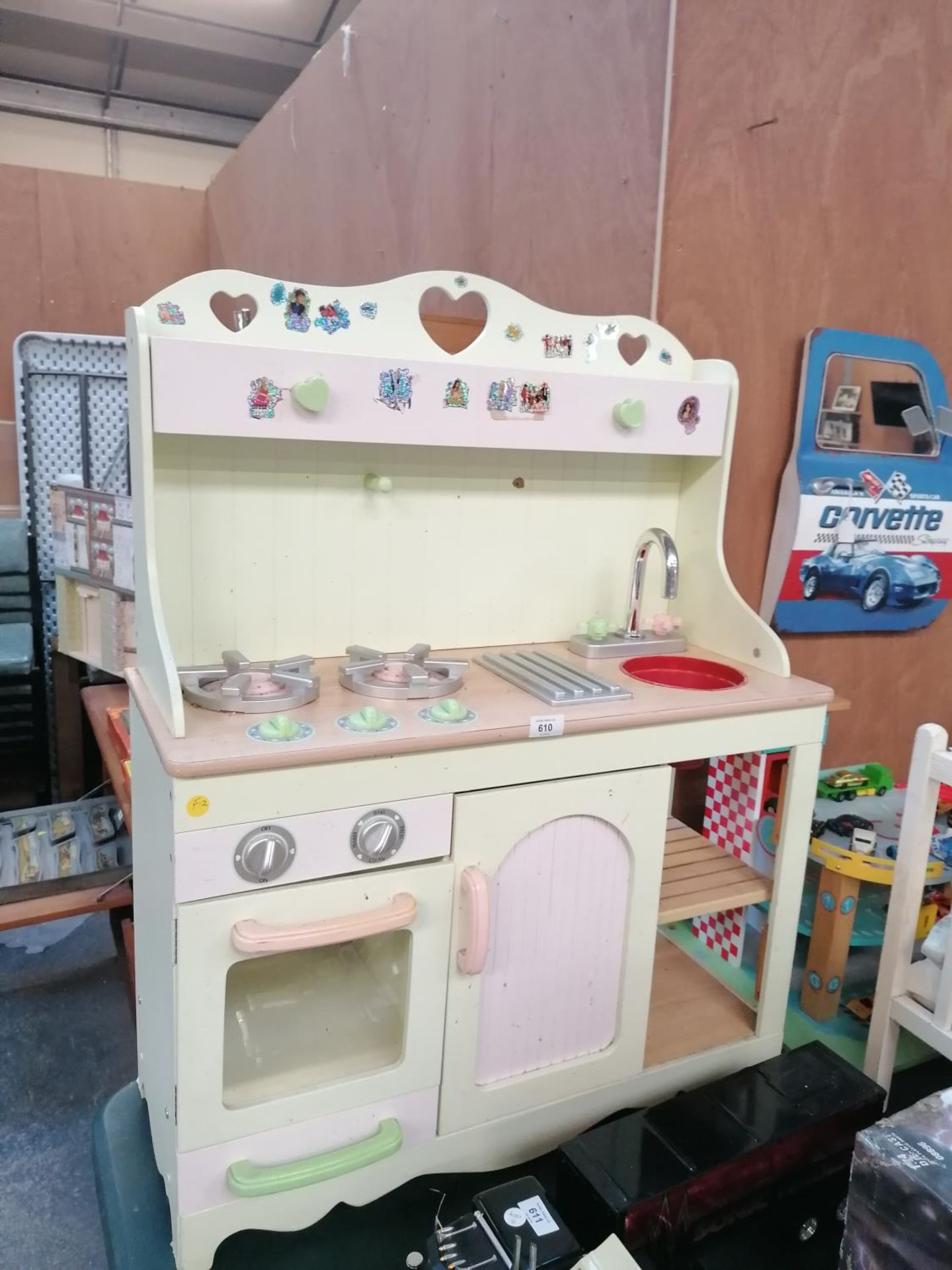 Lot 610 - A WOODEN MODEL CHILDREN'S KITCHEN