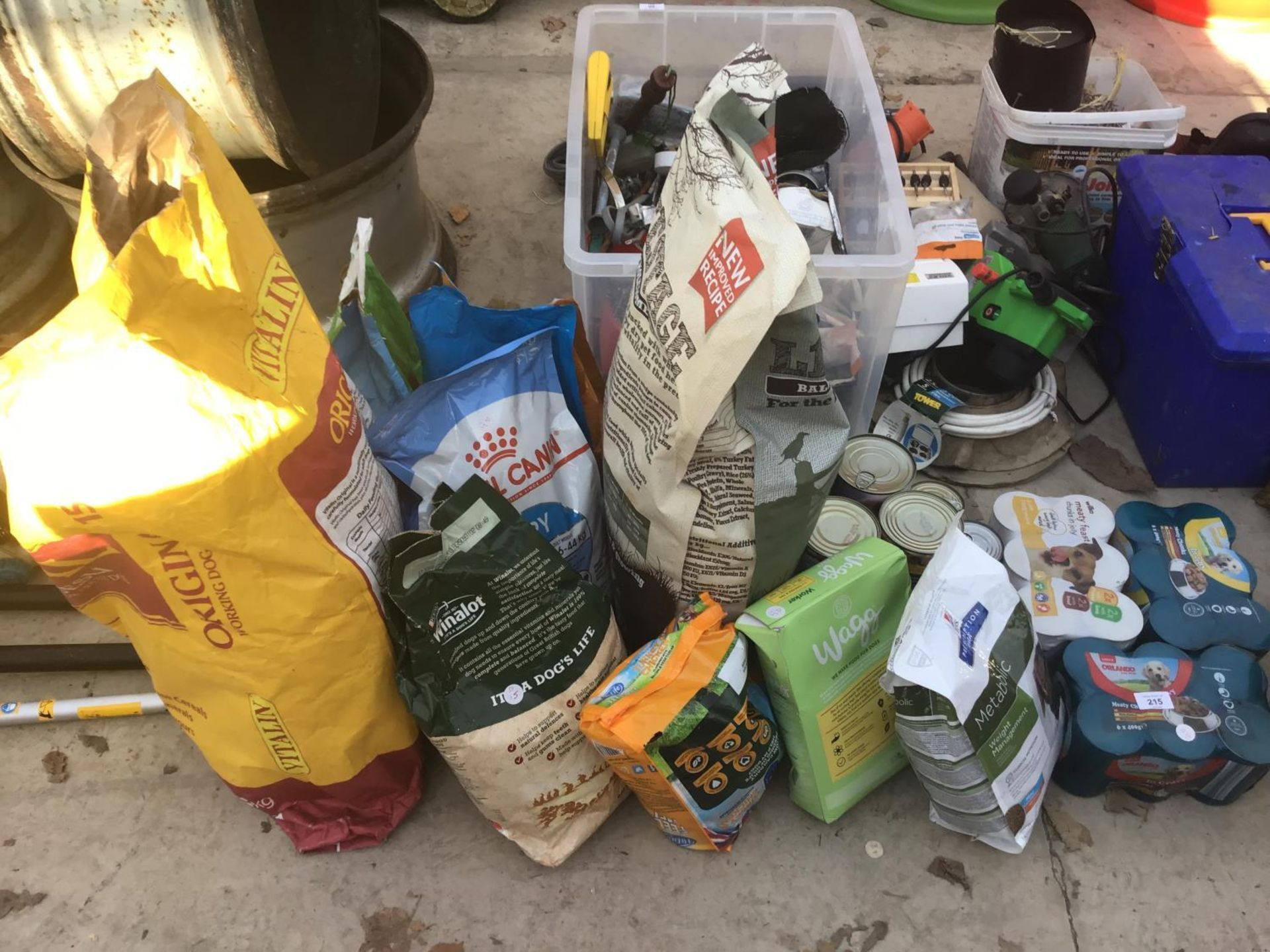 Lot 215 - A LARGE QUANTITY OF DOG FOOD TO INCLUDE ROYAL CANIN, WINALOT, WAGG AND WET FOOD ETC