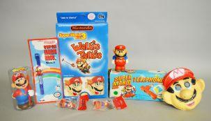 A quantity of Nintendo Super Mario Bros items: Micro Games USA Walkie Talkie; Zeon Watch;