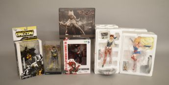 Three 'Batgirl' figures by Iron Sudios, DC Direct and Kotobukiya together with a Batwoman figure,