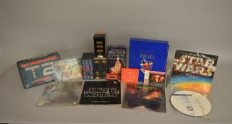 A collections of LPs, Videos etc including; Star Wars The Empire Strikes Back record with book,