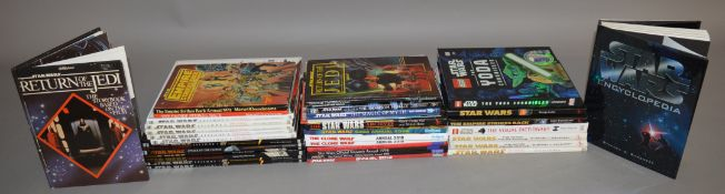 A good quantity of Star Wars related hardback books including various Pedigree Annuals,