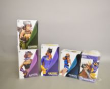 Three DC Collectibles 'Batgirl' figures together with 'Stargirl' and 'Hawkgirl' figures from their