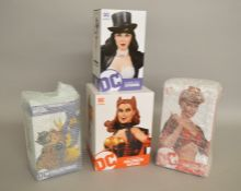Four DC collectables figures including; DC Cover Girls Batgirl numbered limited edition 187/5000,