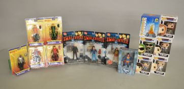 A quantity of Superman and Smallville related items, mostly action figures including 'Green Arrow',