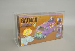 A boxed 1990 Toy Biz Batman Movie Series Joker Van, AFA Graded 75 Ex+/NM in perspex case.
