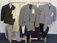 A collection of nine children's movie outfits including all Western Costume co Hollywood California