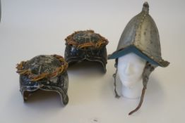 Three movie prop helmets - one Spanish Armada style with ear protector chin strap plus two metal