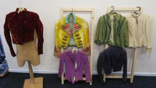 Six waistcoat jackets worn in movie production - one with gold acorn detail,