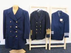 Three coats one from Dominic Gherardi custom tailoring blue jacket with winged star badge at top