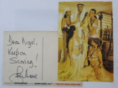 Roger Moore handwritten postcard to the son of the Production Accountant written on The Spy Who