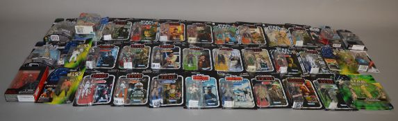 Thirty five carded Star Wars figures by Kenner and Hasbro from a variety of collection series which