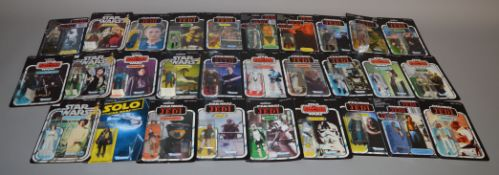 Thirty two Star Wars figures by Kenner on reproduction cards,