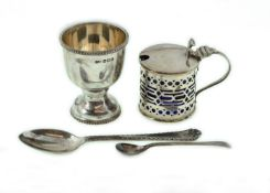A cased silver egg cup & spoosilver cruet setn together with a cased part