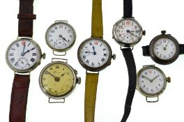 Seven early 20th century mechanical nickel watches, four with uncracked white enamel dials,