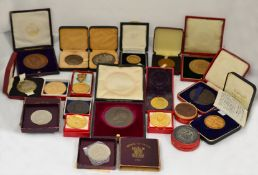 A boxed quantity of 20th century commemorative medallions, most in contemporary boxes,