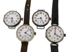 Four early 20th century mechanical silver watches, all with uncracked white enamel dials,