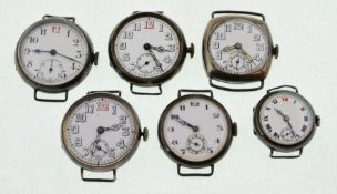 Six early 20th century silver watch heads, the whit enamel dials in overall good condition,