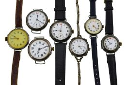 Seven early 20th century mechanical watches, four with uncracked white enamel dials,