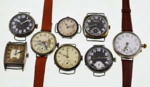 Eight early 20th century silver mechanical watches, three with black dials,