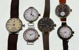 Six early 20th century mechanical nickel watches, to include two black enamel dial examples,