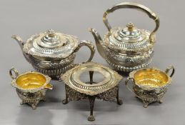 A late Victorian five piece silver tea-set with kettle & stand,