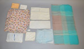 A selection of vintage dolls blankets and bedding.