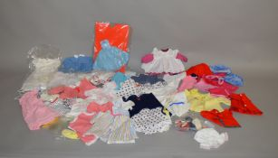 A good selection of vintage dolls clothing, for dolls of various sizes, including; shoes,