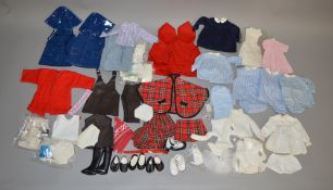 A good selection of vintage unbranded Dolls Clothing/Outfits for dolls of various sizes including