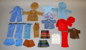 A collection of vintage dolls clothing including caps, two kilts, trousers etc.