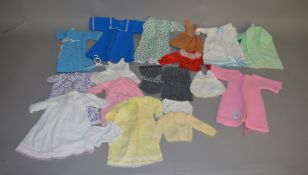 A selection of vintage clothing for Sasha dolls by Dollytogs which includes; a blue coat,