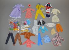 A varied selection of vintage dolls clothing items including a plastic red and white stripe