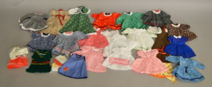 A good selection of vintage unbranded Dolls Clothing/Outfits for dolls of various sizes together
