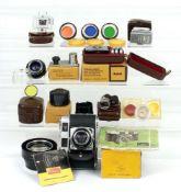 Extensive Kodak Retina IIC (Big C) Outfit. Comprising Kodak Retina IIC Camera with Heligon 50mm f2.