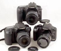 Three Canon EOS Digital Cameras.